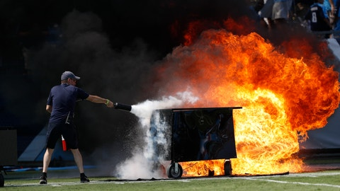 <p>               A fire from a pyrotechnics machine is extinguished before an NFL football game between the Tennessee Titans and the Indianapolis Colts Sunday, Sept. 15, 2019, in Nashville, Tenn. (AP Photo/Wade Payne)             </p>