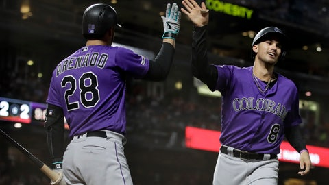 <p>               Colorado Rockies' Josh Fuentes, right, celebrates with Nolan Arenado (28) after scoring against the San Francisco Giants during the seventh inning of a baseball game Wednesday, Sept. 25, 2019, in San Francisco. (AP Photo/Ben Margot)             </p>