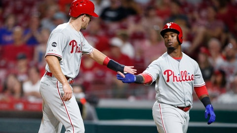 <p>               Philadelphia Phillies' J.T. Realmuto, left, is congratulated by Jean Segura after Realmuto scored on a sacrifice fly by Rhys Hoskins during the fifth inning of the team's baseball game against the Cincinnati Reds, Tuesday, Sept. 3, 2019, in Cincinnati. (AP Photo/Gary Landers)             </p>