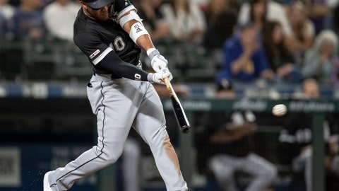 <p>               Chicago White Sox's Yoan Moncada hits an RBI triple off of Seattle Mariners starting pitcher Yusei Kikuchi during the third inning of a baseball game Friday, Sept. 13, 2019, in Seattle. (AP Photo/Stephen Brashear)             </p>