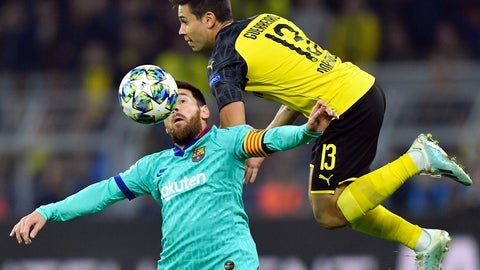 <p>               Barcelona's Lionel Messi, left, fights for the ball with Dortmund's Raphael Guerreiro during the Champions League Group F soccer match between Borussia Dortmund and FC Barcelona in Dortmund, Germany, Tuesday Sept. 17, 2019. (AP Photo/Martin Meissner)             </p>