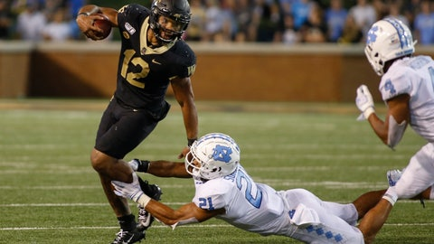 <p>               Wake Forest quarterback Jamie Newman (12) breaks away from North Carolina linebacker Chazz Surratt (21) during the second half of an NCAA college football game in Winston-Salem, N.C., Friday, Sept. 13, 2019. Wake Forest won 24-18. (AP Photo/Nell Redmond)             </p>