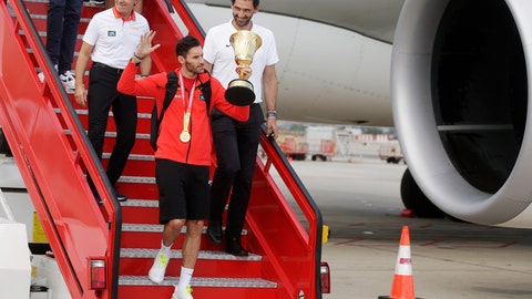 <p>               Spain's captain Rudy Fernandez holds the trophy as he and the team exit a plane on arrival at Barajas airport in Madrid, Spain, Monday Sept. 16, 2019. Spain beat Argentina in their first-place match in the FIBA Basketball World Cup in Beijing, Sunday. (AP Photo/Paul White)             </p>
