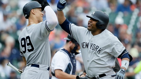 <p>               New York Yankees' Edwin Encarnacion, right, celebrates his two-run home run against the Detroit Tigers with Aaron Judge (99) during the third inning of the first game of a baseball doubleheader, Thursday, Sept. 12, 2019, in Detroit. (AP Photo/Duane Burleson)             </p>