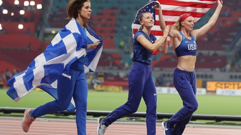 <p>               Anzhelika Sidorova, center, competing as a neutral athlete, celebrates with Katerina Stefanidi, left, competing as a neutral athlete; and Sandi Morris, right, of the United States; after the women's pole vault final at the World Athletics Championships in Doha, Qatar, Sunday, Sept. 29, 2019. Sidorova won the gold medal, Morris won the silver and Stefanidi won the bronze. (AP Photo/Hassan Ammar)             </p>