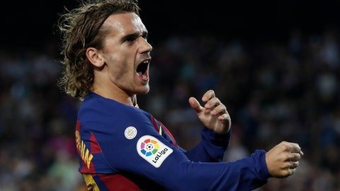 <p>               Barcelona's Antoine Griezmann celebrates after scoring the opening goal during the Spanish La Liga soccer match between FC Barcelona and Villarreal CF at the Camp Nou stadium in Barcelona, Spain, Tuesday, Sep. 24, 2019. (AP Photo/Joan Monfort)             </p>