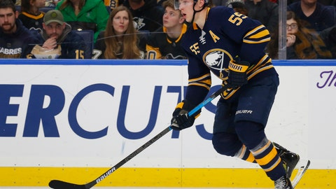 <p>               FILE - In this March 14, 2019, file photo, Buffalo Sabres defenseman Rasmus Ristolainen (55) looks to pass during the second period of an NHL hockey game against the Pittsburgh Penguins, in Buffalo N.Y. Ristolainen says he's happy to report for the start of training camp despite offseason suggestions he'd prefer a change of scenery. What Ristolainen declined to say Thursday, Sept. 12, 2019, was whether he'd still be happy being in Buffalo in March following the NHL's trading deadline.(AP Photo/Jeffrey T. Barnes, File)             </p>