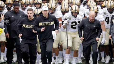 """<p>               FILE - In this Dec. 28, 2018, file photo, Purdue coach Jeff Brohm, center, leads his team onto the field for the the team's NCAA college football game in the Music City Bowl against Auburn in Nashville, Tenn. Brohm knows he has a young team. """"We have a lot to prove."""" Coming off breakout freshman seasons, Purdue wide receiver Rondale Moore and Nevada running back Toa Taua headline Friday night's non-conference opener on the edge of the Sierra where both third-year coaches are anxious to turn the corner on rebuilding efforts. (AP Photo/Mark Humphrey, File)             </p>"""