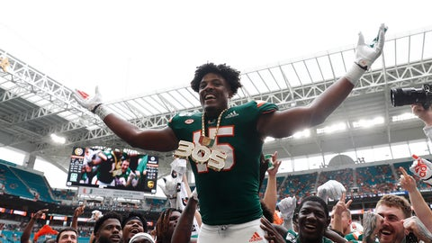 <p>               Miami defensive lineman Gregory Rousseau (15) celebrates a turnover and wears the turnover chain during the first half of an NCAA college football game against Central Michigan, Saturday, Sept. 21, 2019, in Miami Gardens, Fla. (AP Photo/Brynn Anderson)             </p>
