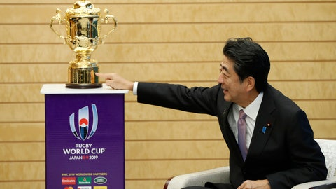 <p>               Japan's Prime Minister Shinzo Abe points to the Webb Ellis trophy during a courtesy call by World Rugby officials as part of the trophy tour ahead of the Rugby World Cup, at Abe's official residence in Tokyo, Thursday, Sept. 12, 2019. (Issei Kato/Pool Photo via AP)             </p>