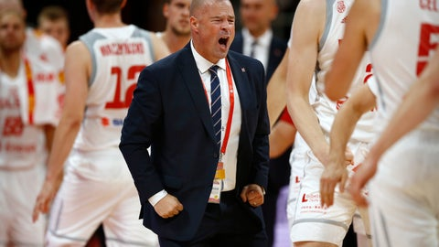<p>               In this Saturday, Aug. 31, 2019 photo, Poland's head coach Mike Taylor celebrates during their group phase basketball game against Venezuela in the FIBA Basketball World Cup at the Cadillac Arena in Beijing. American coach Mike Taylor led Poland to its first World Cup victory in 52 years in the first game against Venezuela. Now he'll try to upset host China in the second game on Monday. (AP Photo/Mark Schiefelbein)             </p>