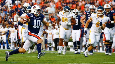 <p>               Auburn quarterback Bo Nix (10) carries the ball during the first half of an NCAA college football game against Kent State, Saturday, Sept. 14, 2019, in Auburn, Ala. (AP Photo/Butch Dill)             </p>
