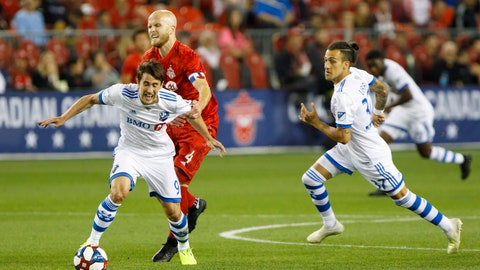 <p>               Toronto FC midfielder Michael Bradley (4) grabs Montreal Impact forward Bojan Krkic as he defends during the first half in the second leg of the Canadian soccer championship, Wednesday, Sept. 25, 2019, in Toronto. (Cole Burston/The Canadian Press via AP)             </p>