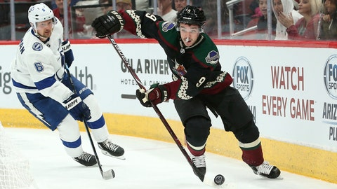 <p>               FILE - In this Oct. 27, 2018, file photo, Arizona Coyotes' Clayton Keller (9) skates with the puck ahead of Tampa Bay Lightning's Anton Stralman during the second period of an NHL hockey game, in Glendale, Ariz. The Arizona Coyotes have locked up forward Clayton Keller through the 2027-28 season, signing him to an eight-year contract extension. The deal announced Wednesday, Sept. 4, 2019, has an average annual salary of $7.15 million.(AP Photo/Ralph Freso, File)             </p>