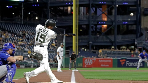 <p>               Pittsburgh Pirates' Pablo Reyes (15) drives in two runs with a triple off Chicago Cubs starting pitcher Jose Quintana during the first inning of a baseball game in Pittsburgh, Thursday, Sept. 26, 2019. (AP Photo/Gene J. Puskar)             </p>