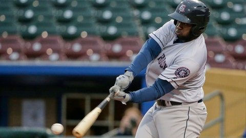 <p>               FILE - In this May 7, 2019, file photo, Round Rock designated hitter Yordan Alvarez, who leads the Triple-A league with 13 home runs, swings at a pitch in Papillion Neb. Home runs surged 58% at Triple-A this season following the switch this year to major league baseballs. A total of 5,752 homers were hit in the International and Pacific Coast Leagues, up from 3,652 in 2018. (AP Photo/Nati Harnik, File)             </p>