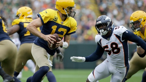 <p>               Green Bay Packers quarterback Aaron Rodgers (12) rolls out as as Denver Broncos outside linebacker Von Miller (58) rushes during the first half of an NFL football game Sunday, Sept. 22, 2019, in Green Bay, Wis. (AP Photo/Mike Roemer)             </p>