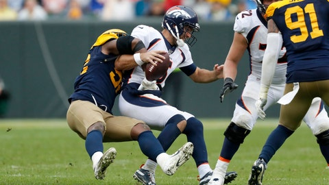 <p>               Denver Broncos quarterback Joe Flacco, right, is sacked by Green Bay Packers linebacker Rashan Gary during the second half of an NFL football game Sunday, Sept. 22, 2019, in Green Bay, Wis. (AP Photo/Matt Ludtke)             </p>