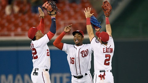 <p>               Washington Nationals' Juan Soto, left, Victor Robles, center, and Adam Eaton, right, celebrate after a baseball game against the Philadelphia Phillies, Monday, Sept. 23, 2019, in Washington. (AP Photo/Nick Wass)             </p>