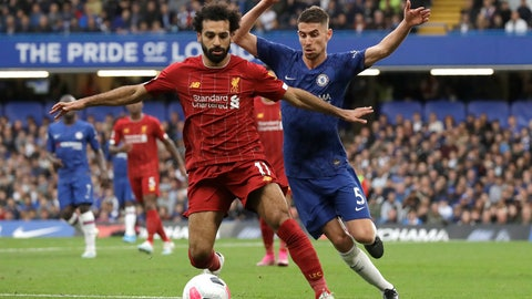<p>               Liverpool's Mohamed Salah, left, and Chelsea's Jorginho compete for the ball during the British premier League soccer match between Chelsea and Liverpool, at the Stamford Bridge Stadium, London, Sunday, Sept. 22, 2019. (AP Photo/Matt Dunham)             </p>