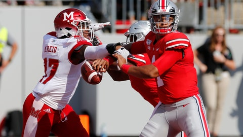 <p>               Miami (Ohio) linebacker Myles Reid, left, knocks the ball away from Ohio State quarterback Justin Fields, causing a fumble and a safety, during the first half of an NCAA college football game Saturday, Sept. 21, 2019, in Columbus, Ohio. (AP Photo/Jay LaPrete)             </p>