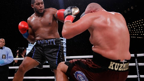 <p>               Michael Hunter, left, knocks down Russia's Sergey Kuzmin during the fifth round of a heavyweight boxing match Friday, Sept. 13, 2019, in New York. Hunter won the fight. (AP Photo/Frank Franklin II)             </p>