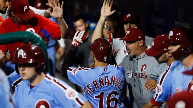 Hernandez helps lead Phillies past Braves