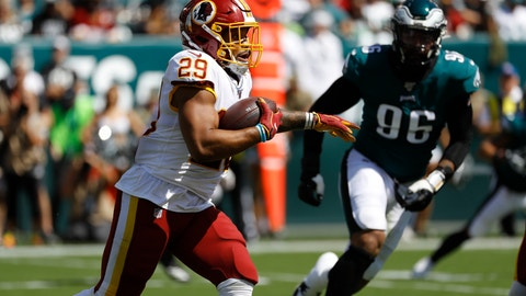 <p>               Washington Redskins' Derrius Guice, left, rushes during the first half of an NFL football game against the Philadelphia Eagles, Sunday, Sept. 8, 2019, in Philadelphia. (AP Photo/Michael Perez)             </p>