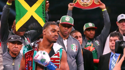<p>               FILE- In this March 16, 2019, file photo,  Errol Spence Jr, gestures for a TV camera before an IBF World Welterweight Championship boxing bout against Mikey Garcia in Arlington, Texas. Spence squares off against against Shawn Porter in a IBF/WBC World welterweight title fight on Saturday.  (AP Photo/Richard W. Rodriguez, File)             </p>