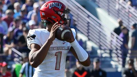 <p>               UNLV quarterback Armani Rogers (1) looks pass during the first half of an NCAA college football game against Northwestern, Saturday, Sept. 14, 2019, in Evanston, Ill. (AP Photo/Matt Marton)             </p>