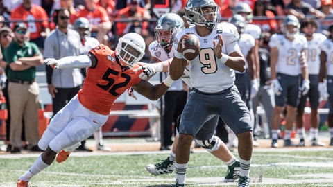 <p>               Eastern Michigan quarterback Mike Glass, III (9) is pressured by Illinois defensive end Ayo Shogbonyo (52) in the first half of a NCAA college football game between Illinois and Eastern Michigan, Saturday, Sept.14, 2019, in Champaign, Ill. (AP Photo/Holly Hart)             </p>