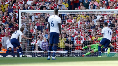 <p>               Tottenham's Harry Kane scores his side's second goal from a penalty shot during their English Premier League soccer match between Arsenal and Tottenham Hotspur at the Emirates stadium in London, Sunday, Sept. 1, 2019. (AP Photo/Alastair Grant)             </p>