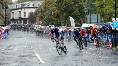 <p>               Cyclists ride under pouring rain during the men elite race, at the road cycling World Championships in Harrogate, England, Sunday, Sept. 29, 2019. (AP Photo/Manu Fernandez)             </p>