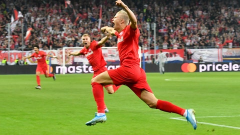 <p>               FC Red Bull Salzburg Erling Braut Haland celebrates after scoring against KRC Genk during the Champions League Group E at Red Bull Arena in Salzburg, Austria, Tuesday, Sept. 17, 2019. (AP Photo/Kerstin Joensson)             </p>