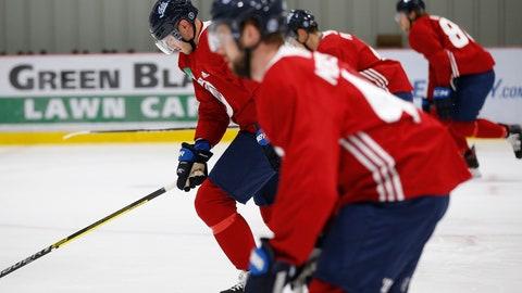 <p>               Winnipeg Jets' Dmitry Kulikov, left, skates during the first day of the NHL training camp in Winnipeg, Manitoba, Friday, Sept. 13, 2019. (John Woods/The Canadian Press via AP)             </p>