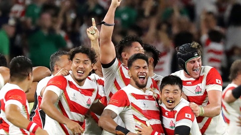 <p>               Japan's players celebrate after winning over Ireland during the Rugby World Cup Pool A game at Shizuoka Stadium Ecopa between Japan and Ireland in Shizuoka, Japan, Saturday, Sept. 28, 2019. (AP Photo/Eugene Hoshiko)             </p>