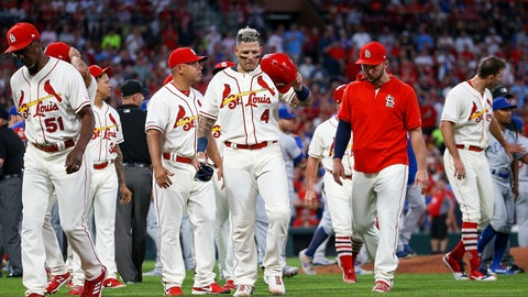 <p>               St. Louis Cardinals' Yadier Molina, center, walks toward first base as the rest of his teammates walk back to the dugout after a bench-clearing argument after he was hit by pitch during the second inning of a baseball game against the Chicago Cubs, Saturday, Sept. 28, 2019, in St. Louis. (AP Photo/Scott Kane)             </p>