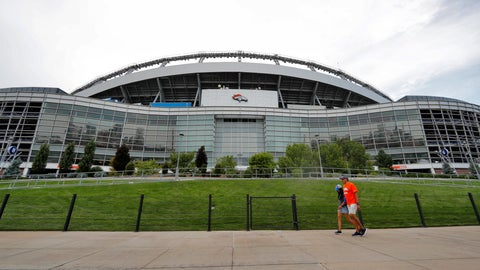 "<p>               FILE - In this Aug. 29, 2019, file photo, fans pass by the east side of Mile High Stadium before an NFL preseason football game between the Arizona Cardinals and the Denver Broncos in Denver. The Broncos announced Wednesday, Sept. 4, 2019, that the team will partner with Colorado-based Empower Retirement on a 21-year deal to name the stadium ""Empower Field at Mile High."" (AP Photo/David Zalubowski, File)             </p>"