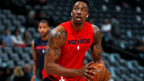 """<p>               FILE - In this March 31, 2019, file photo, injured Washington Wizards center Dwight Howard practices before the Wizards face the Denver Nuggets in an NBA basketball game in Denver. Dwight Howard says he is returning to the Los Angeles Lakers with a new outlook on basketball and his place in it. Howard called it """"a very big blessing"""" to re-sign with the Lakers, who chose him as the improbable replacement for injured center DeMarcus Cousins, Wednesday, Sept. 4, 2019. (AP Photo/David Zalubowski, File)             </p>"""