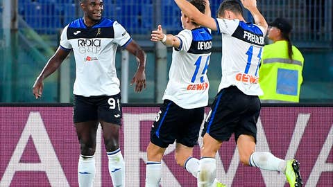 <p>               Atalanta's Duvan Zapata, left, celebrates with his teammates after he scored his side's first goal during a Serie A soccer match between Roma and Atalanta, at Rome's Olympic stadium, in Rome, Wednesday, Sept. 25, 2019. (Ettore Ferrari/ANSA via AP)             </p>