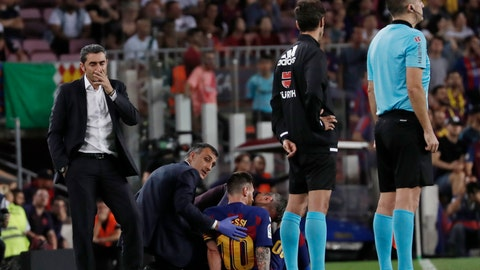 <p>               Barcelona's head coach Ernesto Valverde, left, stands near Lionel Messi after he left the field to get treatment on getting hurt during the Spanish La Liga soccer match between FC Barcelona and Villarreal CF at the Camp Nou stadium in Barcelona, Spain, Tuesday, Sep. 24, 2019. (AP Photo/Joan Monfort)             </p>