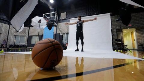 <p>               San Antonio Spurs guard Derrick White poses for photos during an NBA basketball media day Monday, Sept. 30, 2019, in San Antonio. (AP Photo/Eric Gay)             </p>