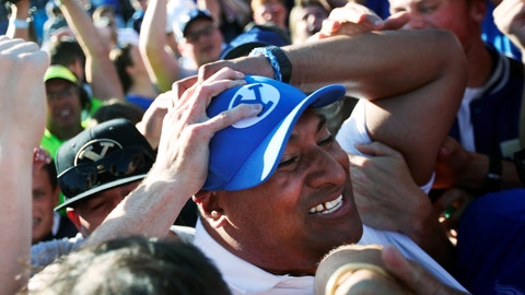 <p>               BYU head coach Kalani Sitake celebrates with fans on the field after defeating Southern California on an interception in overtime of an NCAA college football game, Saturday, Sept. 14, 2019, in Provo, Utah. (AP Photo/George Frey)             </p>