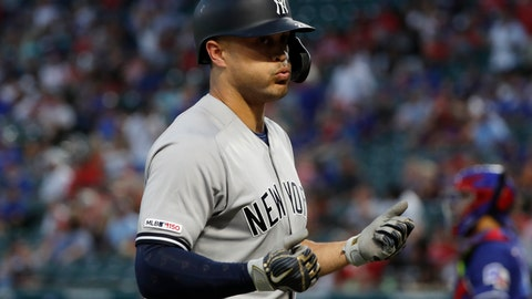 <p>               New York Yankees' Giancarlo Stanton celebrates his solo home run against the Texas Rangers in the first inning of a baseball game in Arlington, Texas, Friday, Sept. 27, 2019. (AP Photo/Tony Gutierrez)             </p>