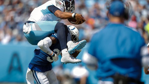 <p>               Tennessee Titans quarterback Marcus Mariota (8) tries to leap over Indianapolis Colts cornerback Pierre Desir (35) in the first half of an NFL football game Sunday, Sept. 15, 2019, in Nashville, Tenn. (AP Photo/Wade Payne)             </p>