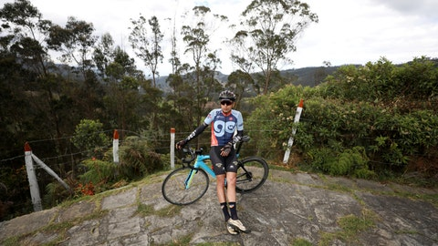 <p>               Former professional cyclist Armando Cardenas props himself up against his bike after pedaling from the towns of Madrid to Zipacon, Colombia, Tuesday, Aug. 27, 2019. In a decade-long career racing professionally, Cardenas never reached the same heights as the country's biggest cycling stars. Though with seven national titles and a medal at the Pan-American Games, the 37-year-old got to live his dream of cycling professionally. Like many of his fellow Colombian cyclists, he also made the decision to dope. (AP Photo/Fernando Vergara)             </p>