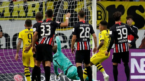 <p>               Dortmund's Jadon Sancho, second right, scores his side's second goal during the Bundesliga soccer match between Eintracht Frankfurt and Borussia Dortmund in the Commerzbank Arena in Frankfurt, Germany, Sunday, Sept.22, 2019. (AP Photo/Michael Probst)             </p>