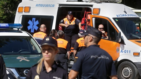 <p>               Police and medics wait near a woodland area in Cercedilla, just outside of Madrid, Spain, Tuesday, Sept. 3, 2019. A search squad of hundreds is combing a mountainous area outside Madrid 11 days after former alpine ski racer and Olympic medalist Blanca Fernandez Ochoa went missing.(AP Photo/Paul White)             </p>