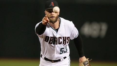 <p>               Arizona Diamondbacks first baseman Christian Walker tosses the ball to Diamondbacks pitcher Matt Andriese to get San Diego Padres' Eric Hosmer out at first base during the fourth inning of a baseball game Friday, Sept. 27, 2019, in Phoenix. (AP Photo/Ross D. Franklin)             </p>