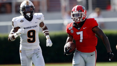 <p>               Georgia running back D'Andre Swift (7) runs as Murray State defensive back Dior Johnson (9) pursues In the first half of an NCAA college football game Saturday, Sept. 7, 2019, in Athens, Ga. (AP Photo/John Bazemore)             </p>